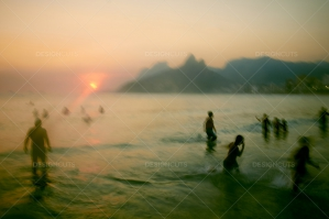 Sunset Over Motion Blurred Swimmers At Ipanema Beach, Rio