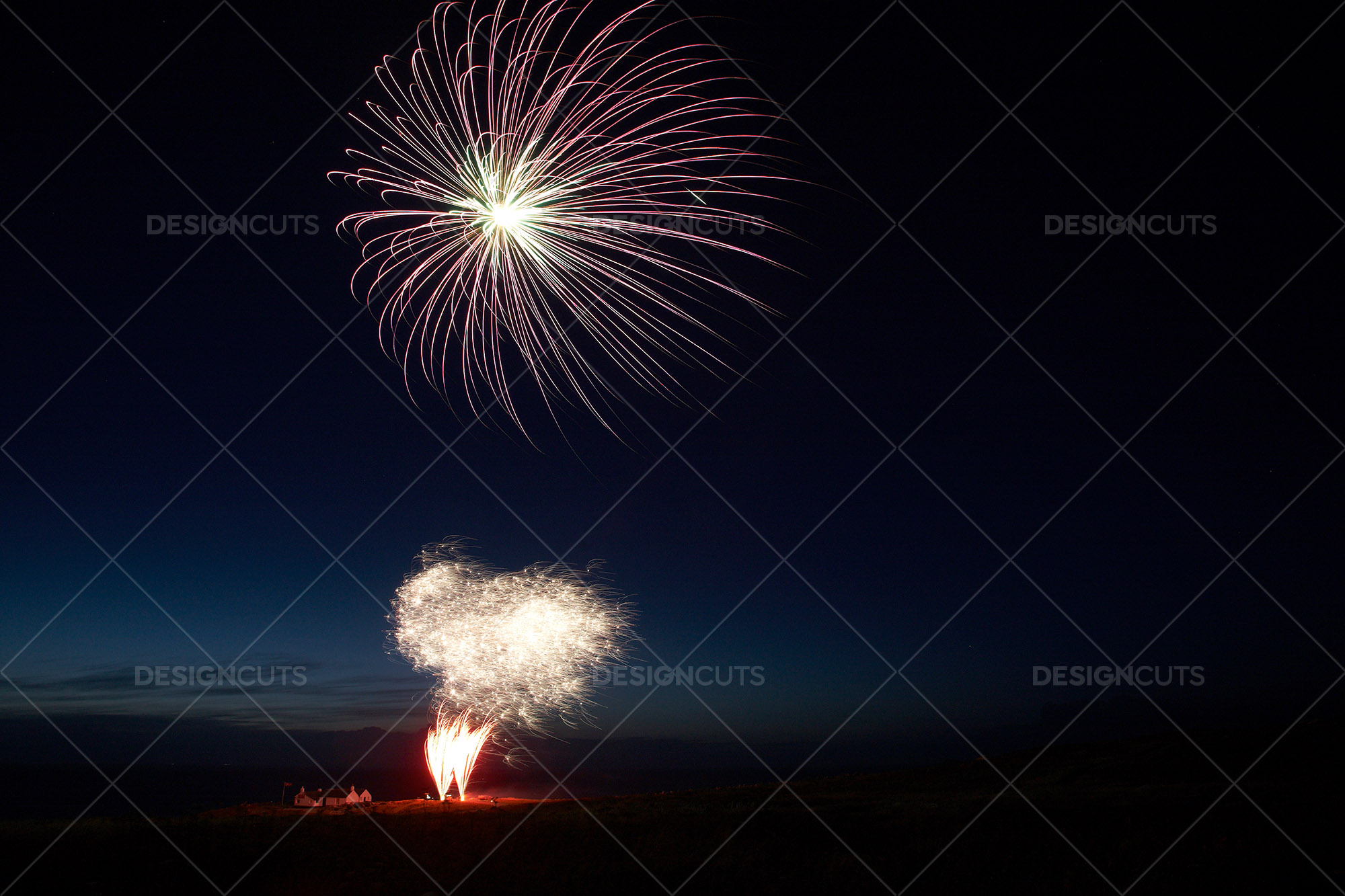 Motion Blurred Fireworks Light Up Night Sky 1