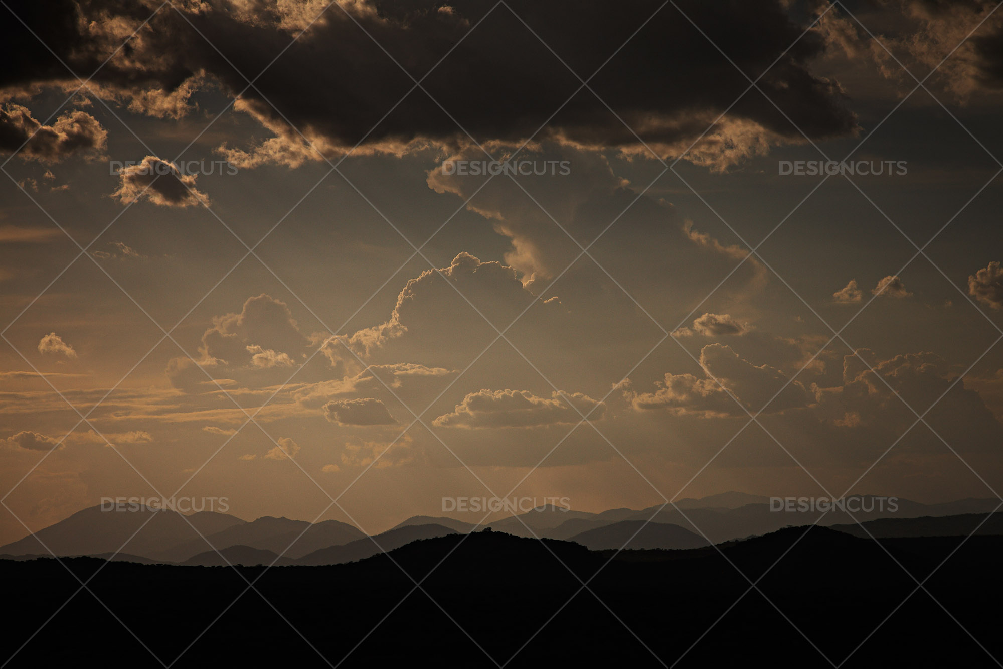 Dramatic Cloud Formation Over Tanzania Hills Landscape