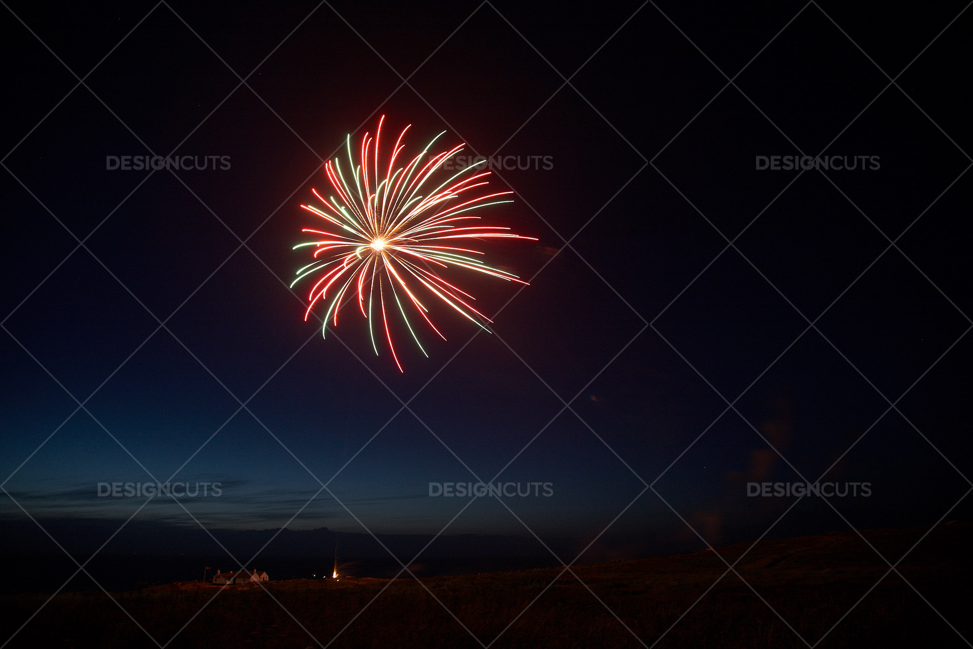 Motion Blurred Fireworks Light Up Night Sky 3