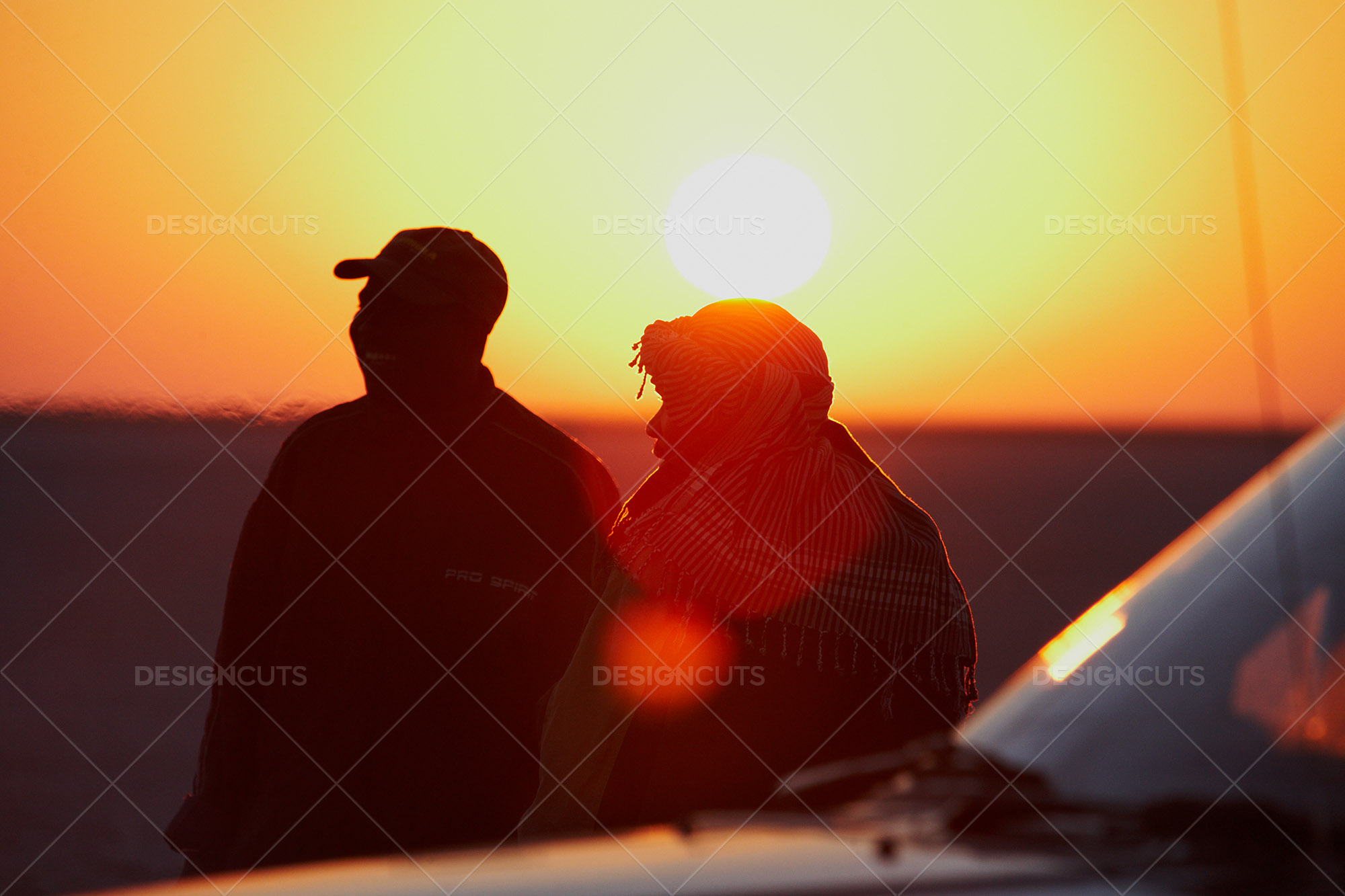 Friends Take In Makgadikgadi Sunrise