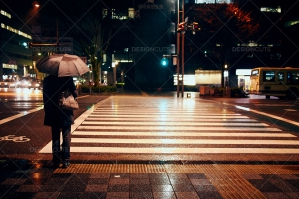 Kyoto Pedestrian Commuter Waits At Crossing In The Rain