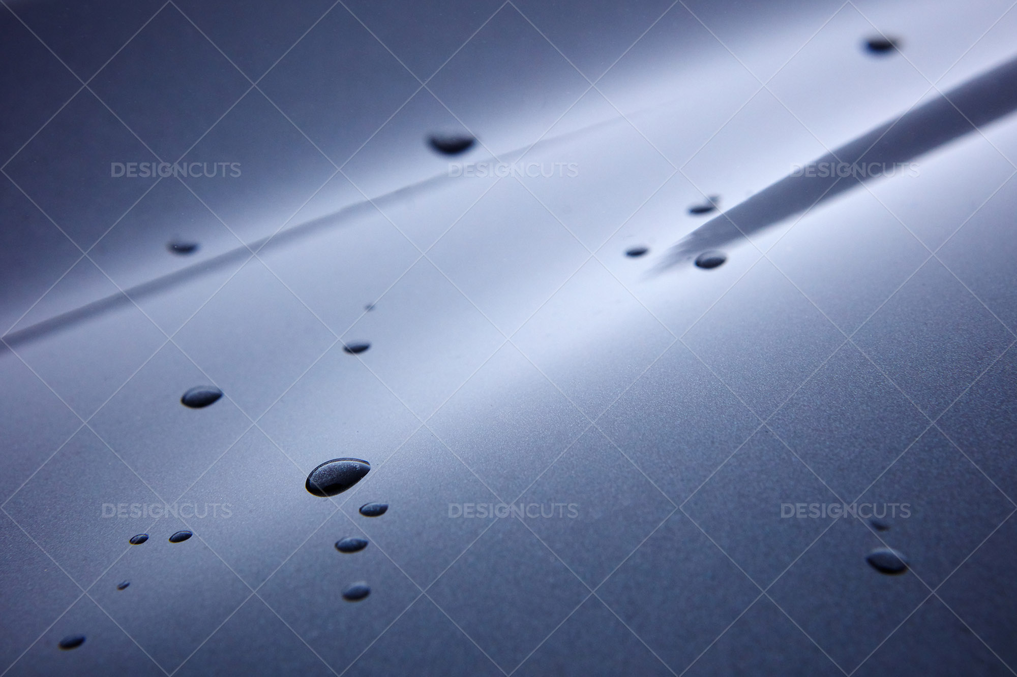 Magnified Water Drops On Metal Frame