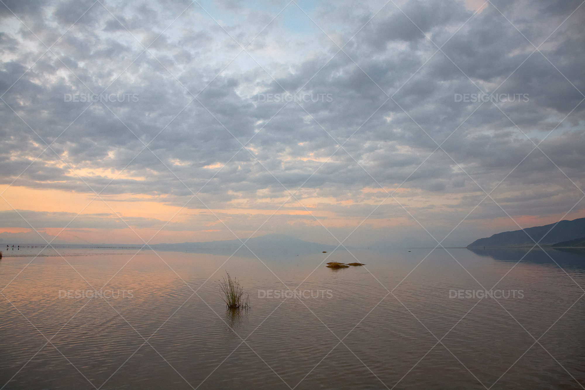 Clouds Gather Over Misty Lake In Kenya At Sunset