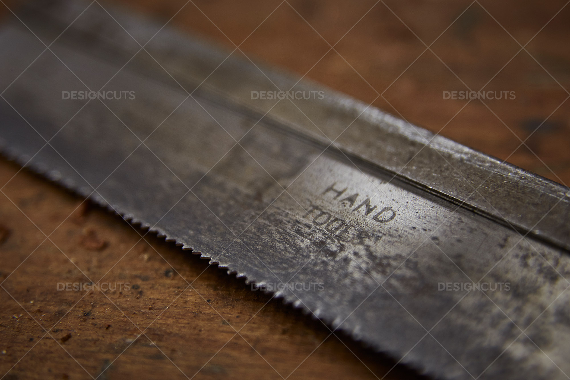 Closeup Of Rusty Hand Tool On Wood Work Surface