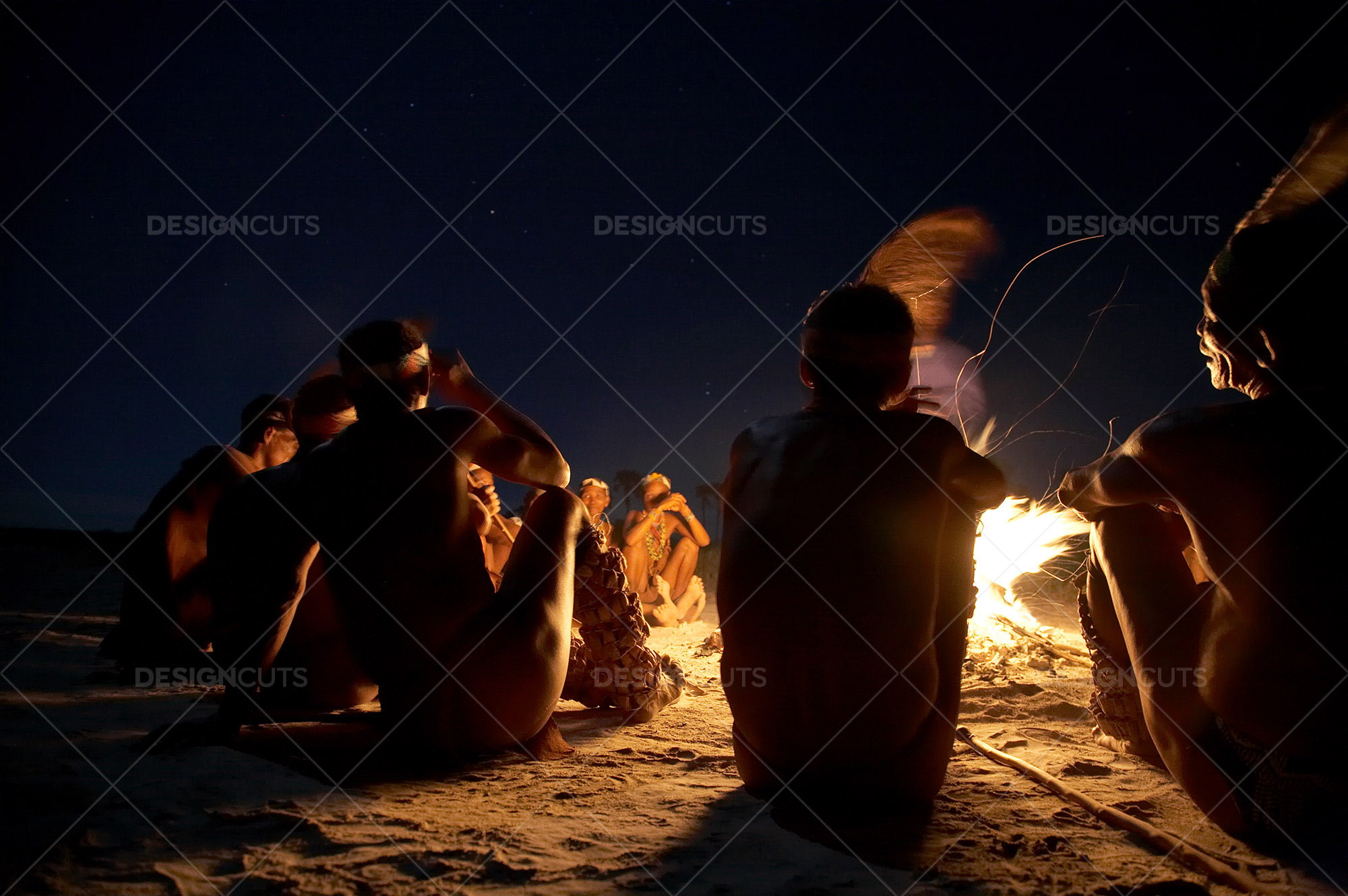 San People Commune By The Fire In Kalahari Desert