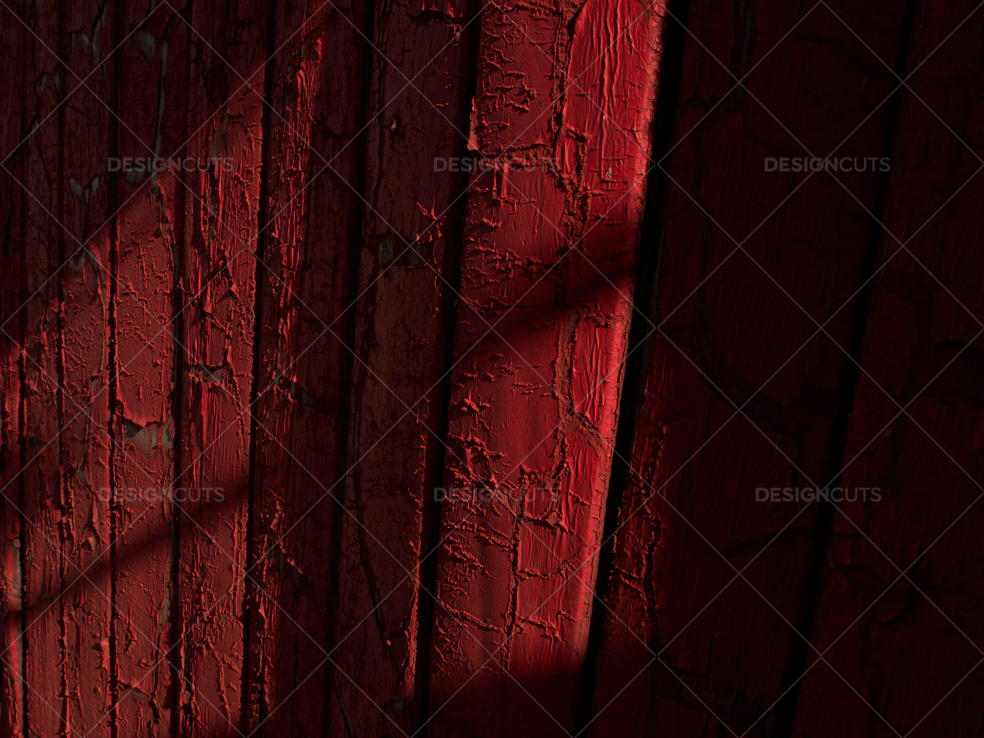 Closeup Of Shadows On Red Painted Fence