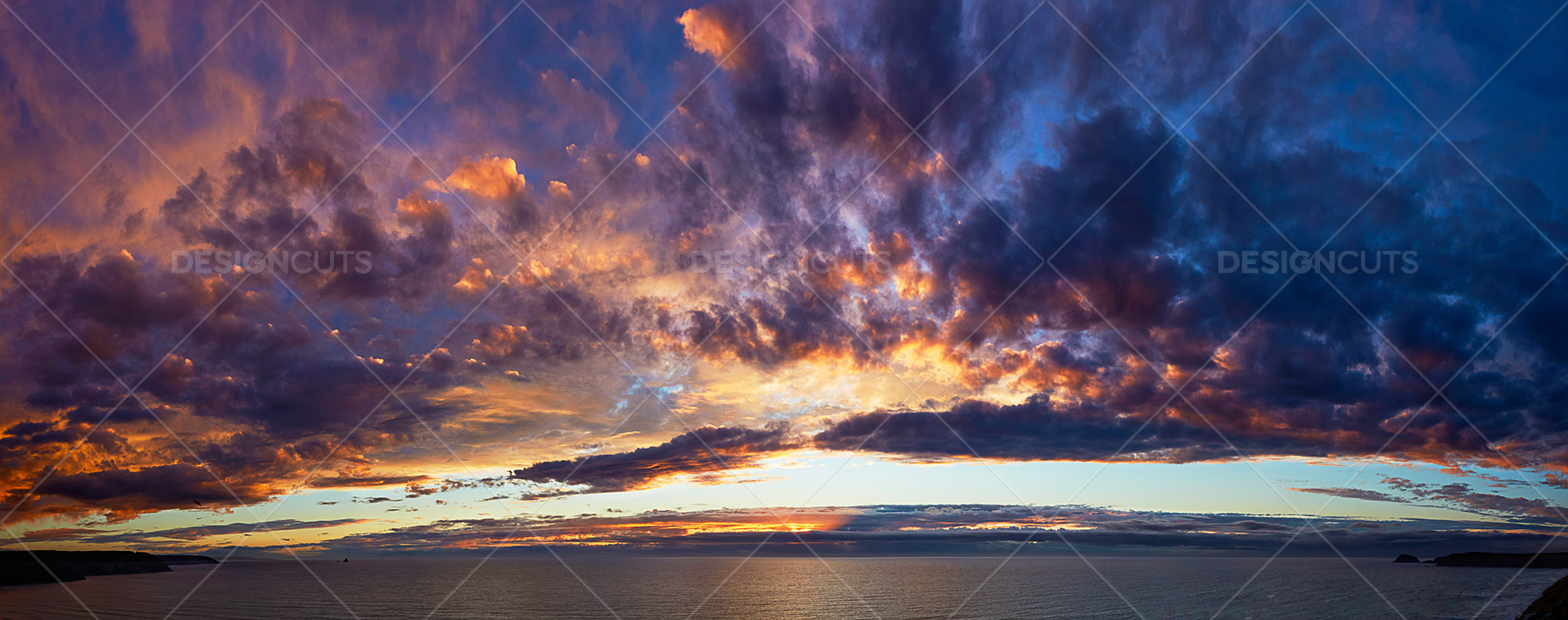 Panorama Of Cloudy Sunset Over Cornwall Sea