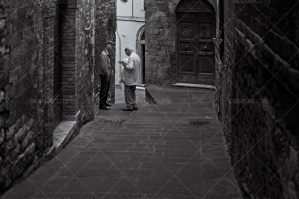 Two Men Chatting In Old Italian Alley