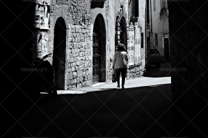 Woman Walks Out On Sunlit Old Italian Streets