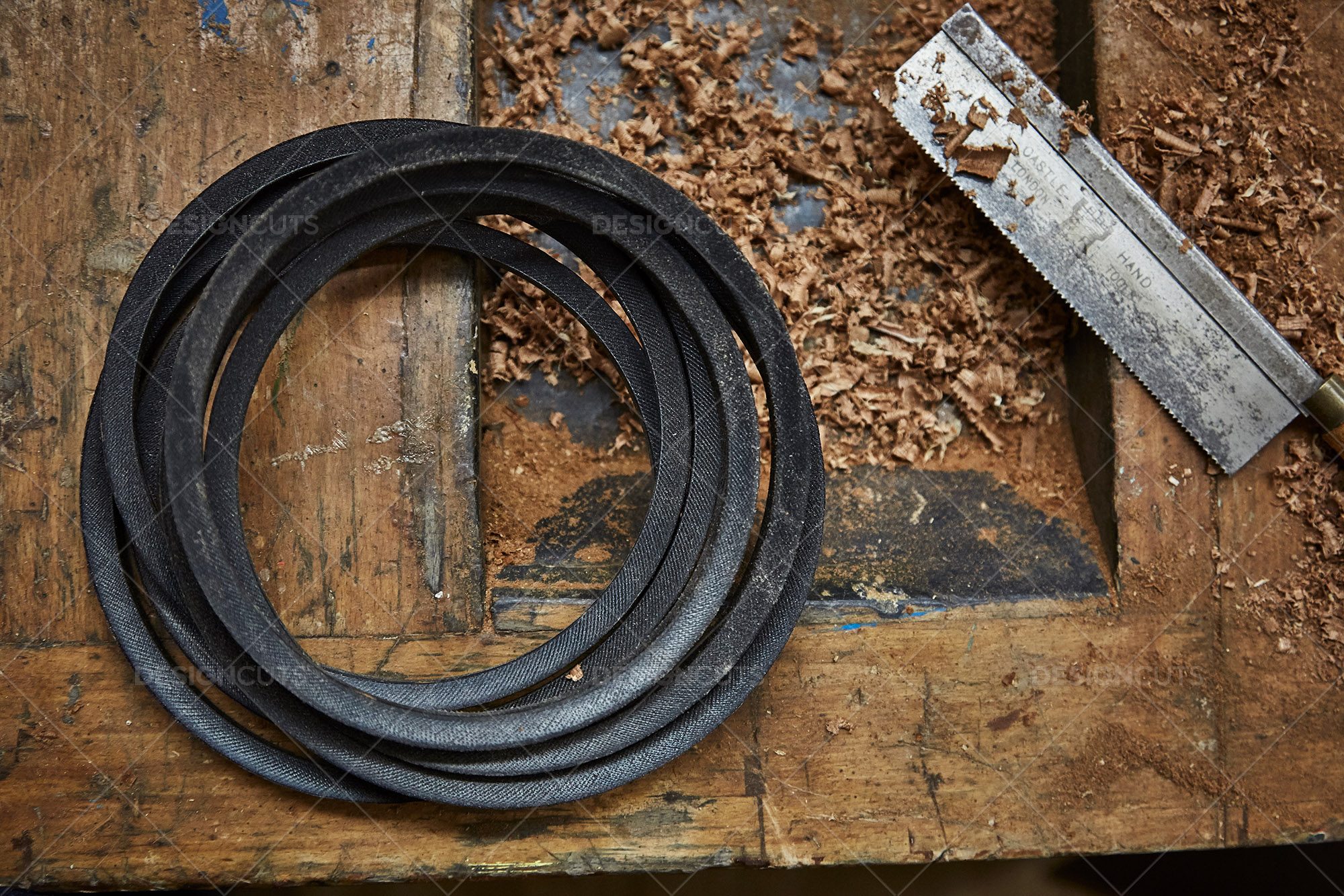 Circular Belt And Hand Saw On Woodwork Top 1