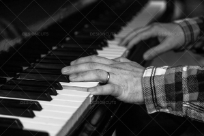 A Close Up Of A Mans Hands Playing A Grand Piano No. 1