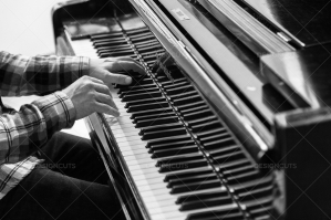 A Close Up Of A Mans Hands Playing A Grand Piano No. 2