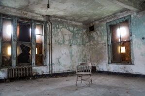 A Lone Chair In An Empty Room In The Derelict Ellis Island Immigration Hospital
