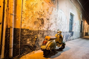 A Scooter Under The Streetlights Of Mytilini At Night
