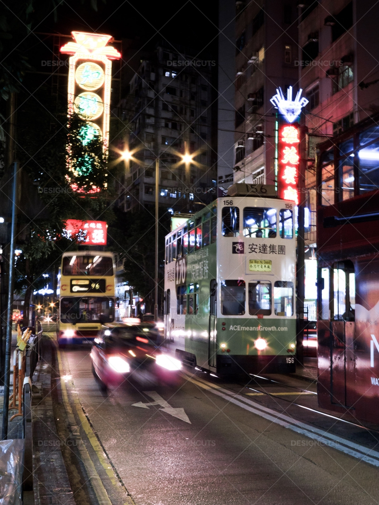 A View Of A Busy Hong Kong Street Lit Up At Night 1