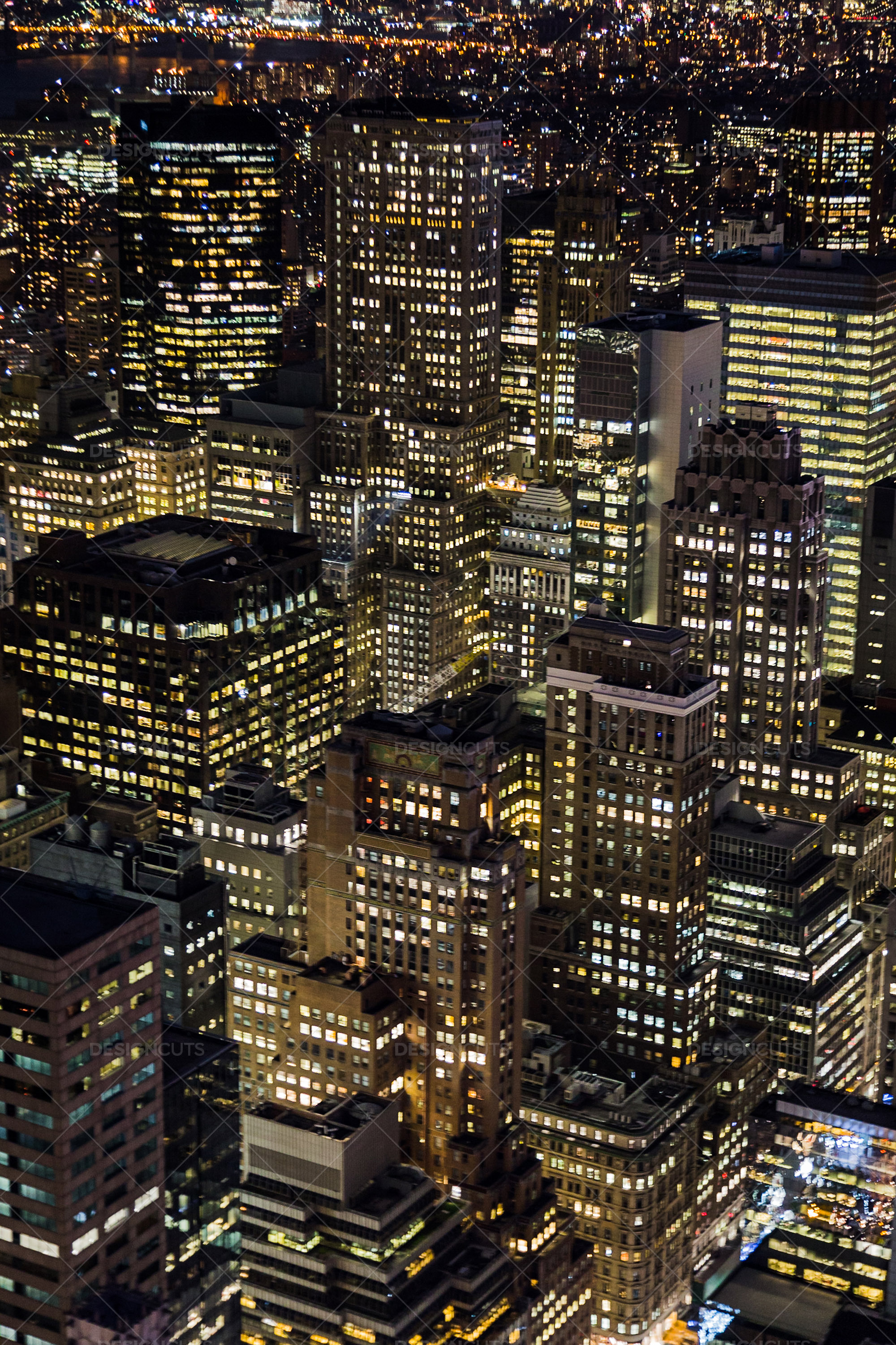 Aerial View Of New York City Skyscrapers Lit Up At Night