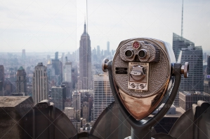 Binoculars And A View Of The New York Skyline From The Top Of The Rock