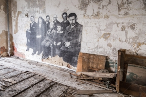 Drawings Of People On An Old Wall In A Dilapidated Room