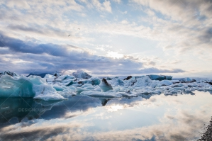 Icebergs And Clouds Reflected In The Water At Jökulsárlón Glacier Lagoon No. 2