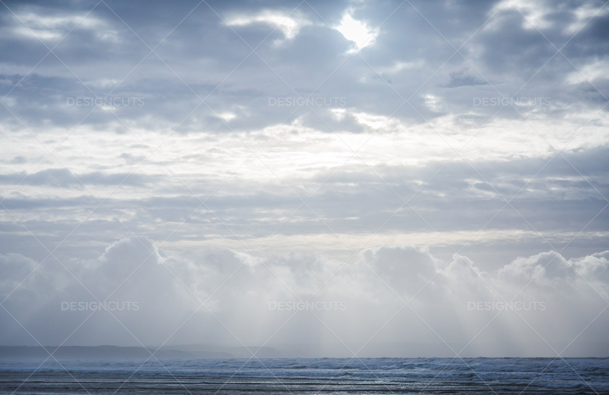 Rays Of Sunlight Shining Through The Clouds Onto On The Sea At Saunton Sands, Devon 1