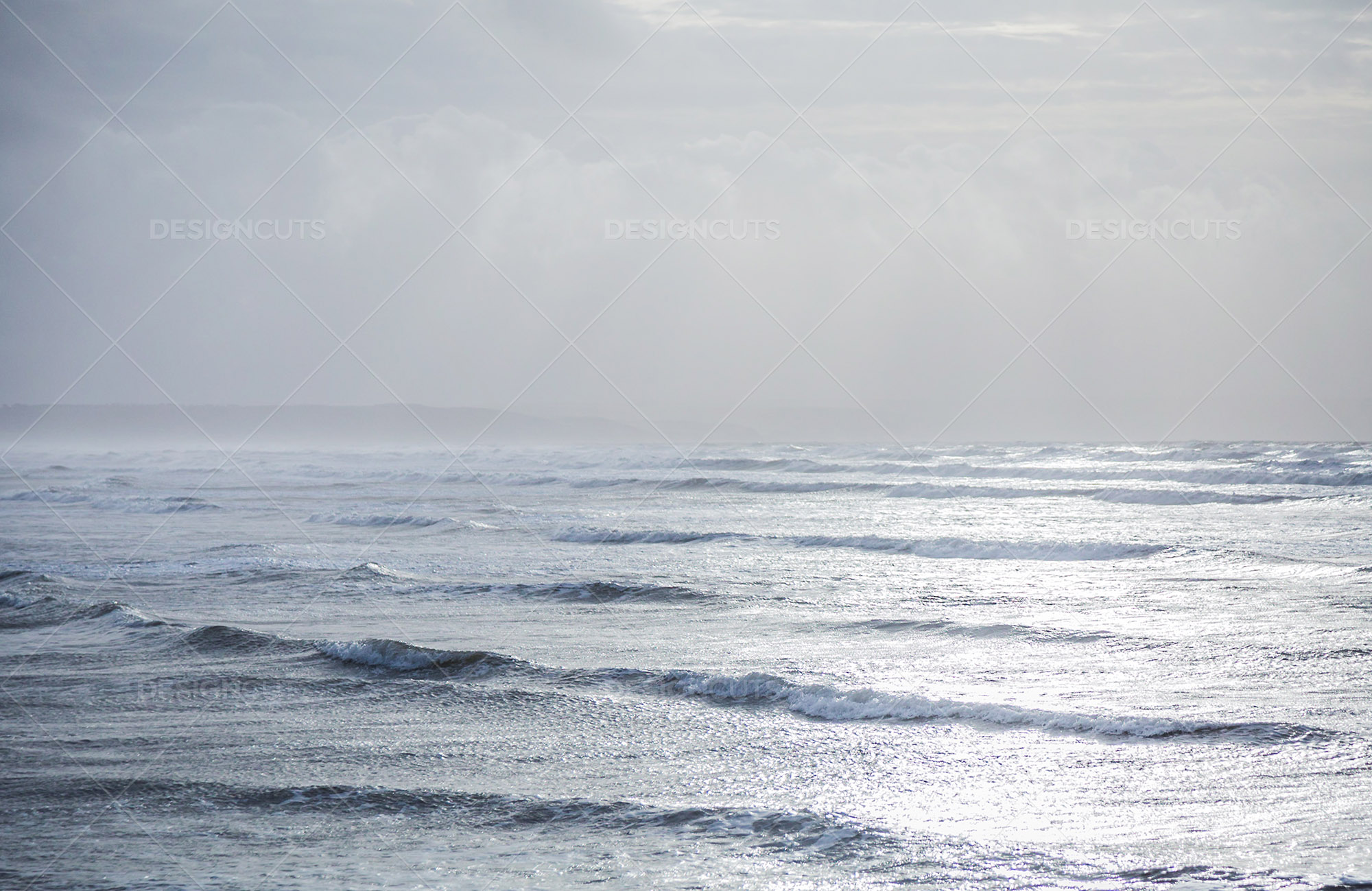 Rays Of Sunlight Shining Through The Clouds Onto On The Sea At Saunton Sands, Devon 3