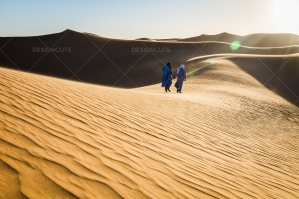 Sahrawi Nomads Walk Along A Sand Dune In The Sahara Desert No. 7