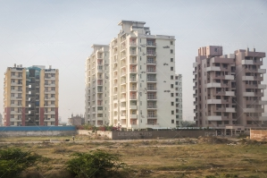 View Across A Field - Three Blocks Of Flats On The Outskirts Of Delhi