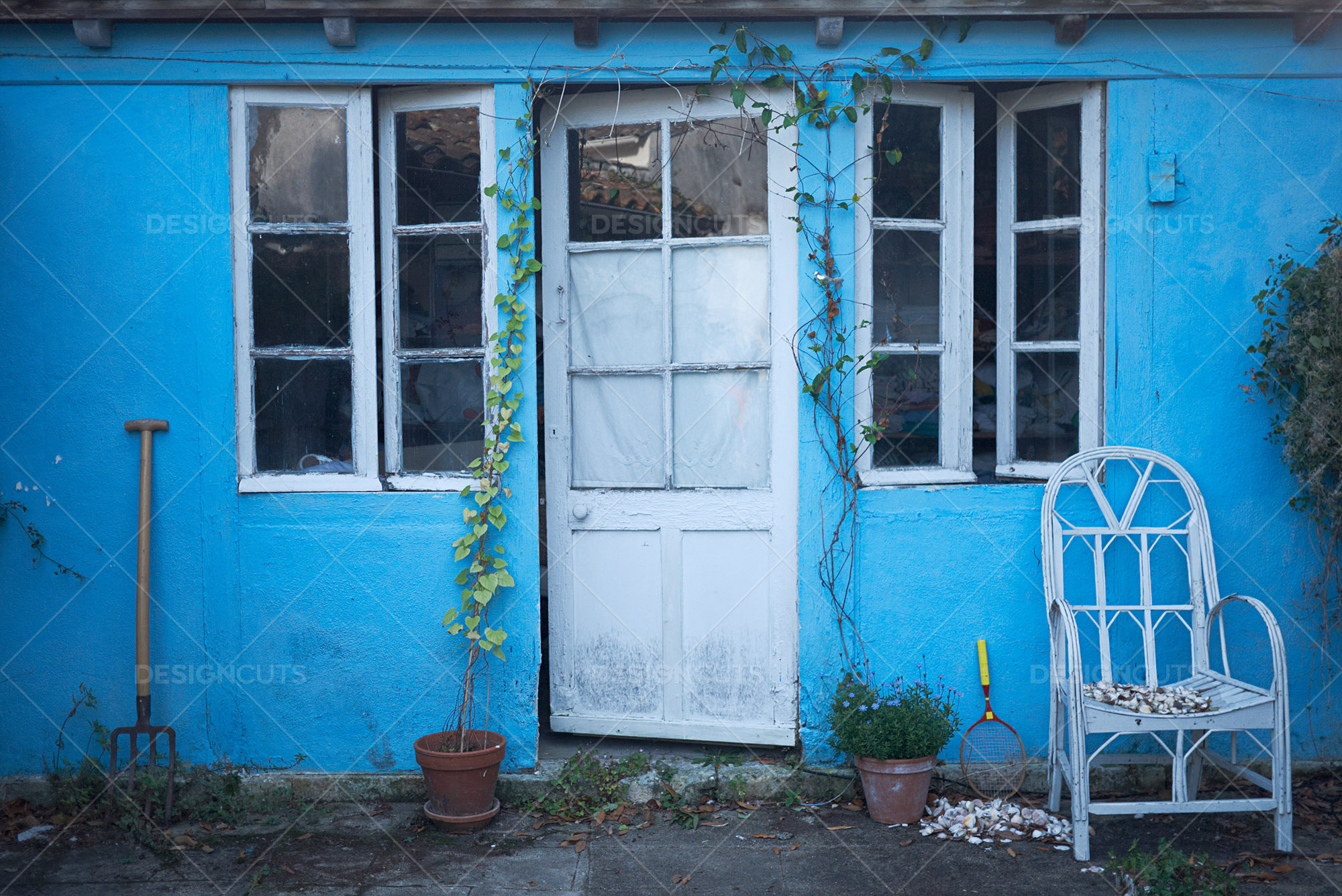 Rustic Blue House With White Door