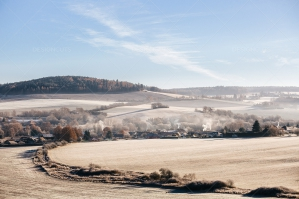Countryside With Village During Frosty Morning