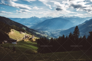 Italian Mountain Village Above Valley With Blue Sky Overhead