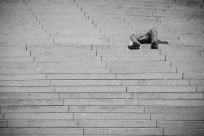 Tired Man Resting On Stairs In Berlin